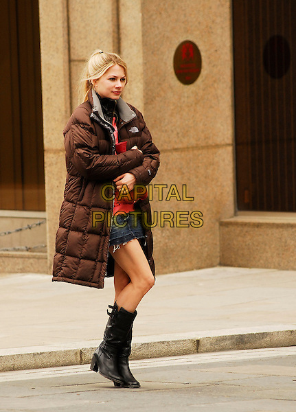 "MICHELLE WILLIAMS.Filming ""Incenidary"" off Pudding Lane in the City, London, England, May 5th 2007..full length brown puffa jacket coat black boots on set film mini skirt.CAP/IA.©Ian Allis/Capital Pictures"