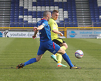 Gregg Wylde flicks the ball past David Raven in the Inverness Caledonian Thistle v St Mirren Scottish Professional Football League Premiership match played at the Tulloch Caledonian Stadium, Inverness on 29.3.14.