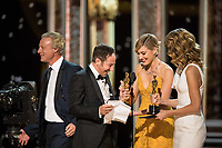 Greta Gerwig and Laura Dern present the Oscar&reg; for best documentary feature to Bryan Fogel for work on &quot;Icarus&quot; during the live ABC Telecast of The 90th Oscars&reg; at the Dolby&reg; Theatre in Hollywood, CA on Sunday, March 4, 2018.<br /> *Editorial Use Only*<br /> CAP/PLF/AMPAS<br /> Supplied by Capital Pictures