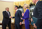 United States President Donald Trump shakes hands with Treasury Secretary Steven Munchin after he was sworn-in as Secretary by Vice President Mike Pence (R) while his fiancee Louise Linton watches, during a ceremony at the White House in Washington, D.C. on February 13, 2017. Mnuchin was confirmed by the Senate 54-47 earlier today. <br /> Credit: Kevin Dietsch / Pool via CNP