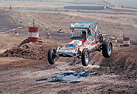Roger Mears (#145) drives in the single-seat desert buggy race at the AC-Delco World Championships of Off-Road Racing, Riverside International Raceway, Sept 5, 1975 and wins for the second year in a row.  Photo by John G. Zimmerman.