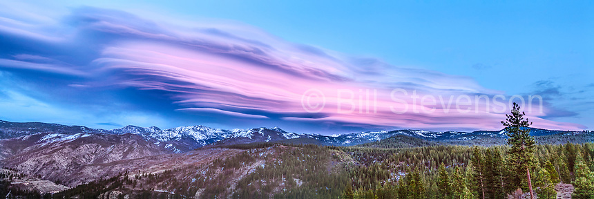 A panorama image of a lenticular cloud above the Sierra Mountains in California