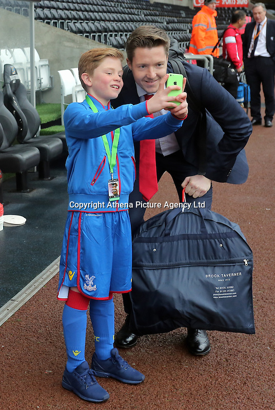 Wayne Hennessey of Crystal Palace poses for a selfie with a young fan before the Barclays Premier League match between Swansea City and Crystal Palace at the Liberty Stadium, Swansea on February 06 2016