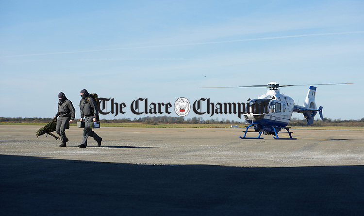 Garda Snipers arrive by helicopter during a bilateral training exercise between An Garda Siochana and the Defence Forces hosted at Shannon Airport. Photograph by John Kelly.