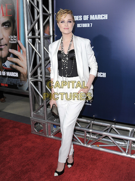 Evan Rachel Wood.The L.A. Premiere of 'The Ides of March' held at The Academy of Motion Picture Arts & Sciences  in Beverly Hills, California, USA..September 27th, 2011.full length suit blazer jacket clutch bag black white pearl corset necklace clutch bag trousers two tone hand in pocket .CAP/RKE/DVS.©DVS/RockinExposures/Capital Pictures.