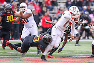 College Park, MD - November 26, 2016: Maryland Terrapins linebacker Jermaine Carter Jr. (23) sacks Rutgers Scarlet Knights quarterback Giovanni Rescigno (17) during game between Rutgers and Maryland at  Capital One Field at Maryland Stadium in College Park, MD.  (Photo by Elliott Brown/Media Images International)