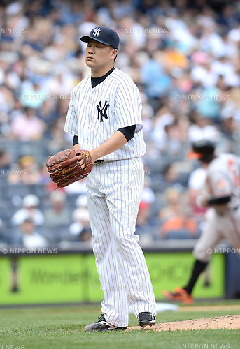 Masahiro Tanaka (Yankees), JUNE 22, 2014 - MLB : Masahiro Tanaka of the New York Yankees reacts after after giving up a home run to Baltimore Orioles' Jonathan Schoop in the 2nd inning during the Major League Baseball game against the Baltimore Orioles at Yankee Stadium in the Bronx, NY, USA. (Photo by AFLO)