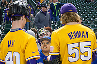 LSU Tigers pitchers Ryan May (40) and Hunter Newman (55) sign autographs before the Houston College Classic against the Nebraska Cornhuskers on March 8, 2015 at Minute Maid Park in Houston, Texas. LSU defeated Nebraska 4-2. (Andrew Woolley/Four Seam Images)