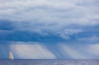 A sailboat cruising off the coast of Maui.