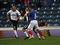 Danny Carmichael shields the ball from Ian Black as Ryan McGuffie assists in the Rangers v Queen of the South Quarter Final match in the Ramsdens Cup played at Ibrox Stadium, Glasgow on 18.9.12.