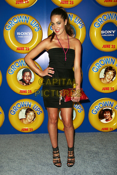 ROXY OLIN .The screening of 'Grown Ups' at the Ziegfeld Theatre in New York City, NY, USA, 23rd June 2010..arrivals full length strapless  black dress hand on hip red necklace pink cross clutch bag strappy sandals .CAP/ADM/PZ.©Paul Zimmerman/AdMedia/Capital Pictures.