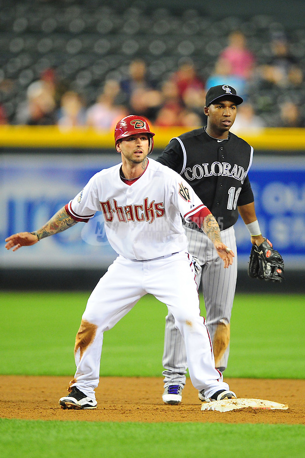May 3, 2011; Phoenix, AZ, USA; Arizona Diamondbacks second baseman Ryan Roberts (near) and Colorado Rockies infielder Jonathan Herrera at Chase Field. Mandatory Credit: Mark J. Rebilas-