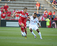 Chicago midfielder Logan Pause (12) dribbles away from Toronto forward Joao Plata (7).  The Chicago Fire defeated Toronto FC 2-0 at Toyota Park in Bridgeview, IL on August 21, 2011.
