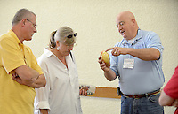 NWA Democrat-Gazette/BEN GOFF @NWABENGOFF<br /> Jeff Simpson (from left) and wife Tena Simpson of Bella Vista listen as Charles Peek of the Stateline Woodturners talks about one of his pieces on Sunday Sept. 13, 2015 during the Woodcarvers of Northwest Arkansas show at Frisco Station Mall in Rogers.