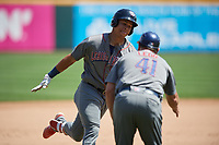 Lehigh Valley IronPigs Jan Hernandez (16) is congratulated by coach Greg Legg (41) as he rounds the bases after hitting a home run during an International League game against the Buffalo Bisons on June 9, 2019 at Sahlen Field in Buffalo, New York.  Lehigh Valley defeated Buffalo 7-6 in 11 innings.  (Mike Janes/Four Seam Images)