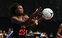 24.02.2018 Malawi's Mwai Kumwenda in action during the Malawi v Fiji Taini Jamison Trophy netball match at the North Shore Events Centre in Auckland. Mandatory Photo Credit ©Michael Bradley.