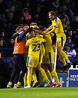 Joe Pigott of AFC Wimbledon is mobbed after scoring the equaliser  with Mitch Pinnock of AFC Wimbledon to make the score 1-1during Portsmouth vs AFC Wimbledon, Sky Bet EFL League 1 Football at Fratton Park on 11th January 2020
