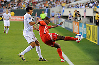 Luis Moreno (3) of Panama plays the ball away from Brian Ching (11) of the United States (USA). The United States (USA) defeated Panama (PAN) 2-1 during a quarterfinal match of the CONCACAF Gold Cup at Lincoln Financial Field in Philadelphia, PA, on July 18, 2009.