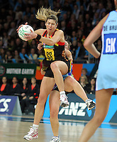 28.06.2010 Magic's Irene Van Dyk and Steels Wendy Frew in action during the ANZ Champs Semi Final netball match between the Magic and Steel played at Vector Arena in Auckland. ©MBPHOTO/Michael Bradley
