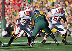Wisconsin Badgers offensive linemen Travis Frederick (72) and Ricky Wagner (58) block during the 2012 Rose Bowl NCAA football game in Pasadena, California on January 2, 2012. The Ducks won 45-38. (Photo by David Stluka)