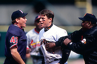 SAN FRANCISCO, CA -  J.T. Snow of the San Francisco Giants is held back by manager Dusty Baker while arguing with an umpire during a game against the St. Louis Cardinals at Candlestick Park in San Francisco, California in 1998.  Photo by Brad Mangin