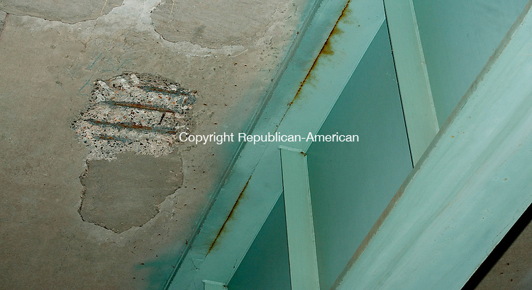 WATERBURY, CT--- -111815JS04--Exposed rebar and rust can be seen on the underside of the exit 21 off ramp on I-84 in Waterbury. <br /> Jim Shannon Republican-American