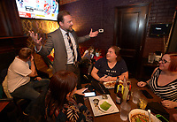 NWA Democrat-Gazette/ANDY SHUPE<br /> Josh Mahony, Democratic candidate for Arkansas' 3rd Congressional District, speaks Tuesday, Nov. 6, 2018, with visitors during a watch party for the Washington County Democratic Party of Arkansas at Farrell's Lounge in Fayetteville.