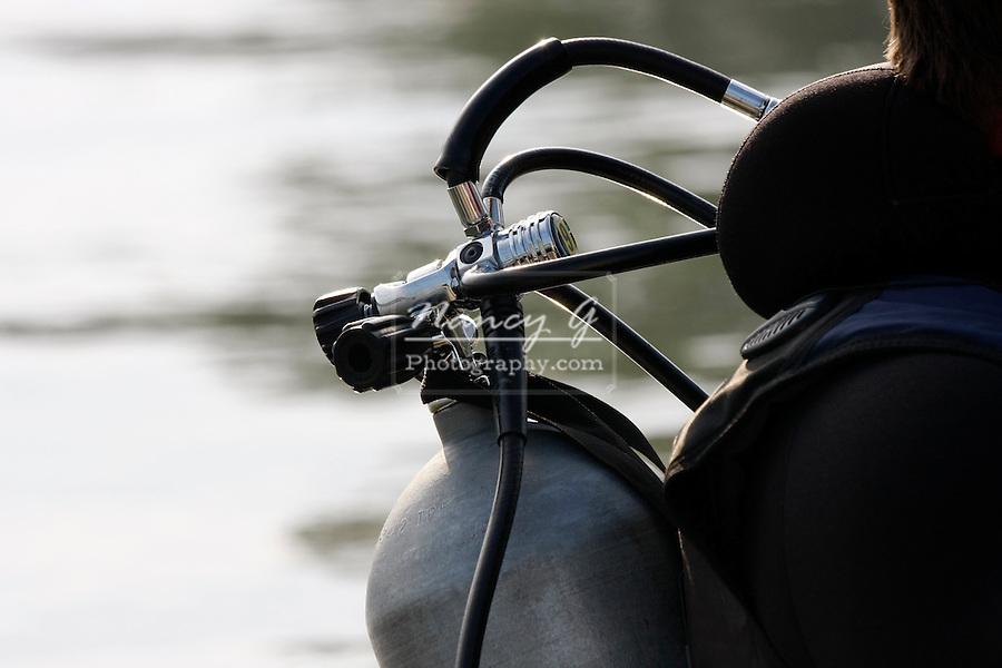 Scuba diver oxygen tank before doing a rescue dive