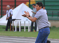 FLORIDABLANCA -COLOMBIA, 19-02-2014.  Wilson Gutierrez técnico de Independiente Santa Fe durante encuentro con Alianza Petrolera por la fecha 6 de la Liga Postobon I 2014 disputado en el estadio Alvaro Gómez Hurtado de la ciudad de Floridablanca./ Independiente Santa Fe coach Wilson Gutierrez during match against Alianza petrolera for the 6th date of the Postobon League I 2014 played at Alvaro Gomez Hurtado stadium in Floridablanca city Photo:VizzorImage / Duncan Bustamante / STR