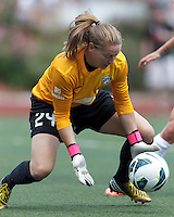 Boston Breakers goalkeeper Ashley Phillips (24) controls a blast. In a National Women's Soccer League (NWSL) match, Portland Thorns FC (white) defeated Boston Breakers (blue), 2-1, at Dilboy Stadium on July 21, 2013.