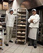 November 25, 2009. Wake Forest, North Carolina.. Ilya Koltusky, right, and his assistant, Matt Wright, of Sweet Loralee Pastries prepare Thanksgiving pies..