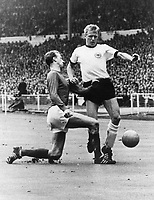 1966 World Cup Final-England: English defender Jack Charlton (left) tries to stop German forward Siegfried Held from advancing towards the goal during the World Cup final between England and Germany on 30 July 1966 at Wembley Stadium in London, Germany. In the end England will win its first ever World Cup title with a dramatic 4:2 victory in extra time.