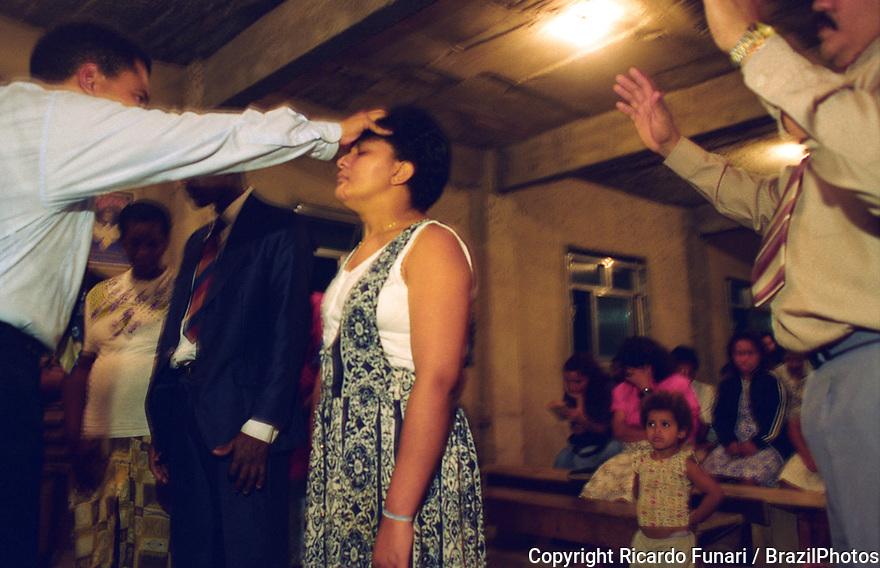 Protestant preacher at a revival meeting in a Pentacostal cult in Favela da Mangueira, Rio de Janeiro, Brazil.