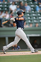 Second baseman Oswaldo Cabrera (10) of the Charleston RiverDogs bats in a game against the Greenville Drive on Friday, April 27, 2018, at Fluor Field at the West End in Greenville, South Carolina. Greenville won, 5-4. (Tom Priddy/Four Seam Images)