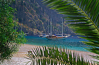 Antalya, Turkey, October 2005. The romantic hippy beach settlement of Butterfly Valley near Fethiye. Sailing the Turkish coast in a wooden Gulet takes one along the most beautiful stretches of the Mediterranean. Small fishing villages, ancient Lycian and Byzantine ruins are scattered in the mountainous landscape lined by tranquil beaches and small islands. Photo by Frits Meyst / MeystPhoto.com