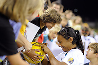 Marta (10) of Marta XI signs autographs after  the Women's Professional Soccer (WPS) All-Star Game at KSU Stadium in Kennesaw, GA, on June 30, 2010.