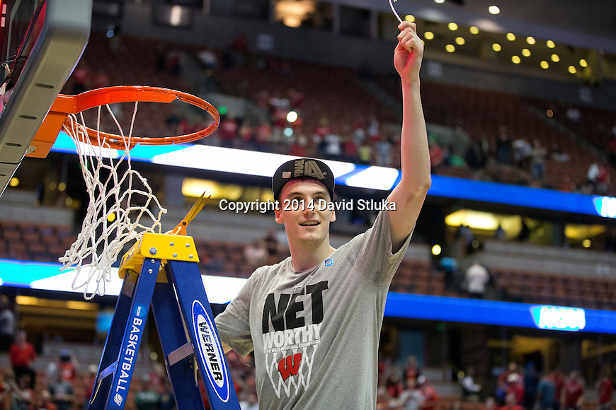 Wisconsin Badgers forward Sam Dekker (15) cuts down a piece of the net after the Western Regional Final NCAA college basketball tournament game against the Arizona Wildcats Saturday, March 29, 2014 in Anaheim, California. The Badgers won 64-63 (OT). (Photo by David Stluka)