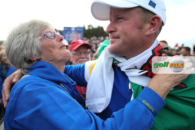 Jamie Donaldson (EUR) hugs his Mother during Sunday's Singles at the 2014 Ryder Cup from Gleneagles, Perthshire, Scotland. Picture:  David Lloyd / www.golffile.ie