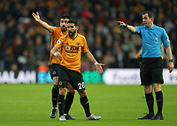 Wolverhampton Wanderers' Ruben Neves and Joao Moutinho gesture to Referee Peter Bankes after a decision went against them<br /> <br /> Photographer Lee Parker/CameraSport<br /> <br /> The Premier League - Wolverhampton Wanderers v Newcastle United - Saturday 11th January 2020 - Molineux - Wolverhampton<br /> <br /> World Copyright © 2020 CameraSport. All rights reserved. 43 Linden Ave. Countesthorpe. Leicester. England. LE8 5PG - Tel: +44 (0) 116 277 4147 - admin@camerasport.com - www.camerasport.com