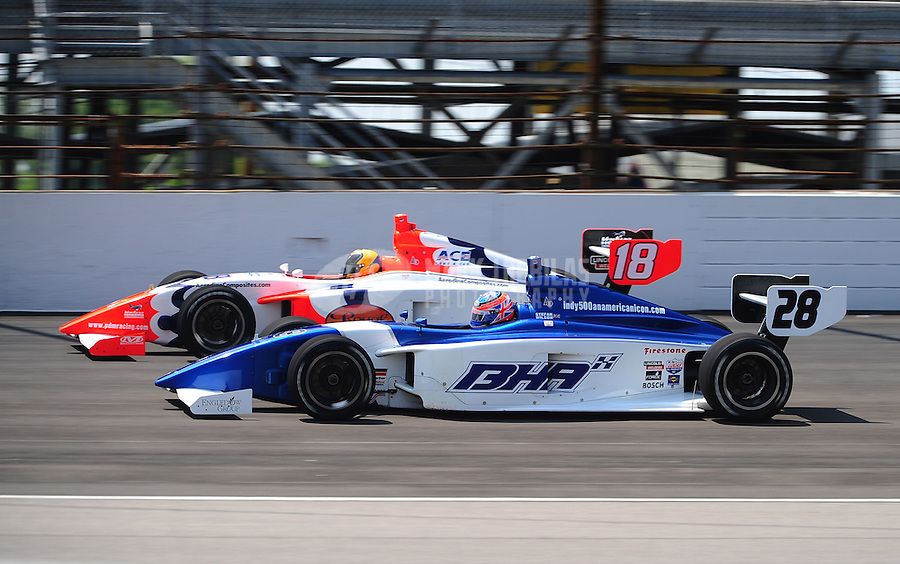 May 28, 2010; Indianapolis, IN, USA; Indy Light Series driver Stefan Wilson (28) races alongside Rodrigo Barbosa (18) during the Freedom 100 at the Indianapolis Motor Speedway. Mandatory Credit: Mark J. Rebilas-