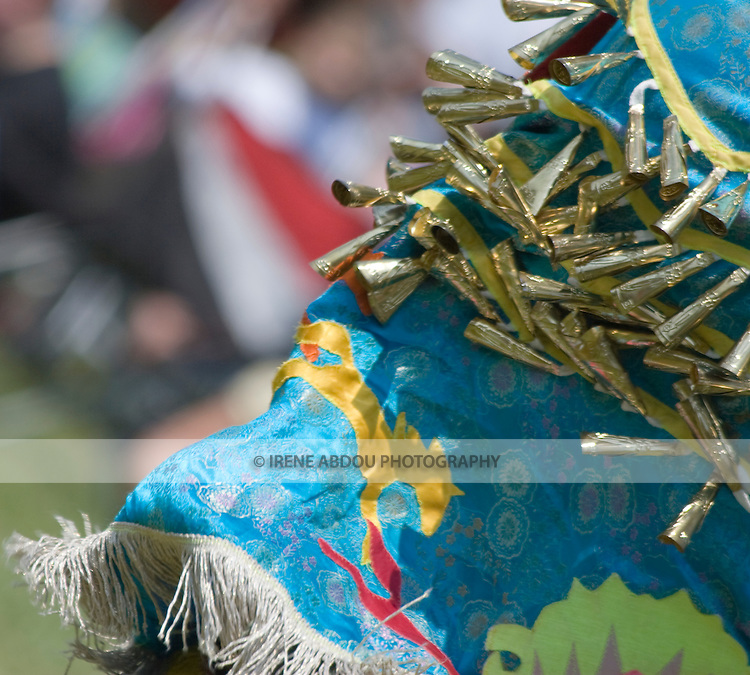 The bells of the Jingle Dancer's skirt bounce in all directions during a jingle dance at the 8th annual Red Wing Native American PowWow in Virginia Beach, Virginia.