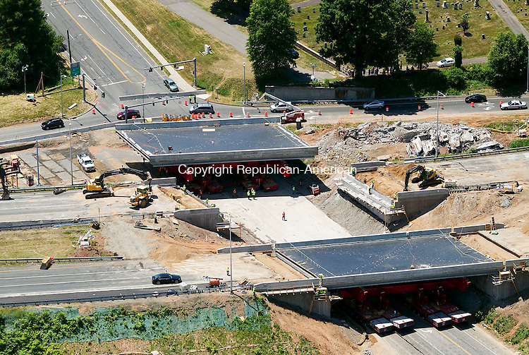 Southington, CT- 28 June 2014-062814CM03- An arial photograph showing construction on I-84 in Southington on Saturday.  I-84 remains closed in both directions, at exit 30 as well as the area around I-84 on Marion Avenue. The Connecticut Department of Transportation will continue working to replace the overpasses, which is expected be completed on Monday.    Christopher Massa Republican-American