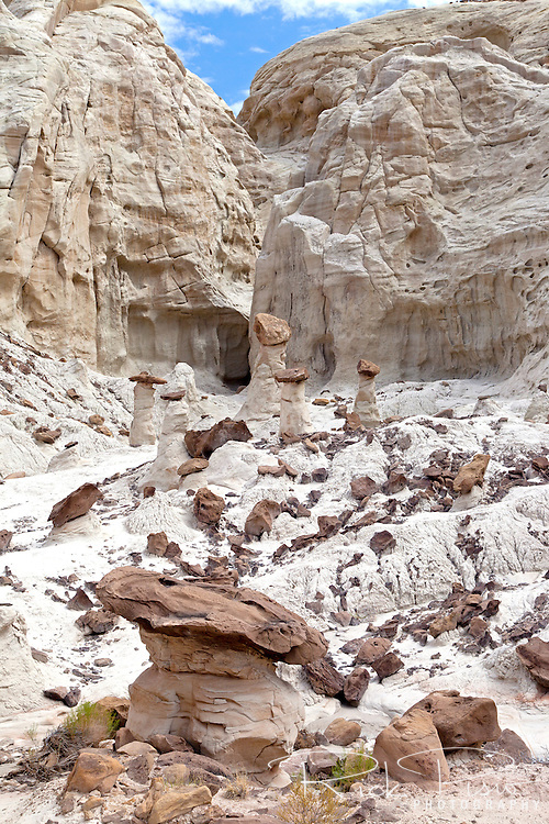 Toadstool formation in Grand Staircase Escalante National Monument. The toadstools are formed when a Dakota Sandstone boulder causes the underlying sandstone layer to erode at a slower pace directly beneath it, forming a spire.