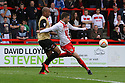 Robin Shroot of Stevenage gets ready to shoot watched by Elliot Omozusi of Leyton Orient<br />  - Stevenage v Leyton Orient - Sky Bet League 1 - Lamex Stadium, Stevenage - 17th August, 2013<br />  © Kevin Coleman 2013