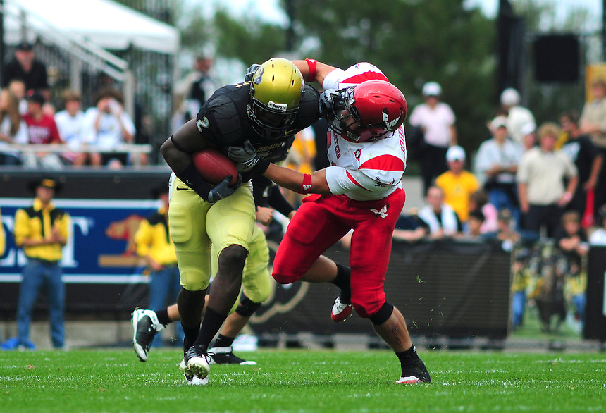 06 September 08: Colorado tailback Darrell Scott (2) gives a stiff-arm to Eastern Washington linebacker Zach Johnson. The Colorado Buffaloes defeated the Eastern Washington Eagles 31-24 at Folsom Field in Boulder, Colorado. FOR EDITORIAL USE ONLY