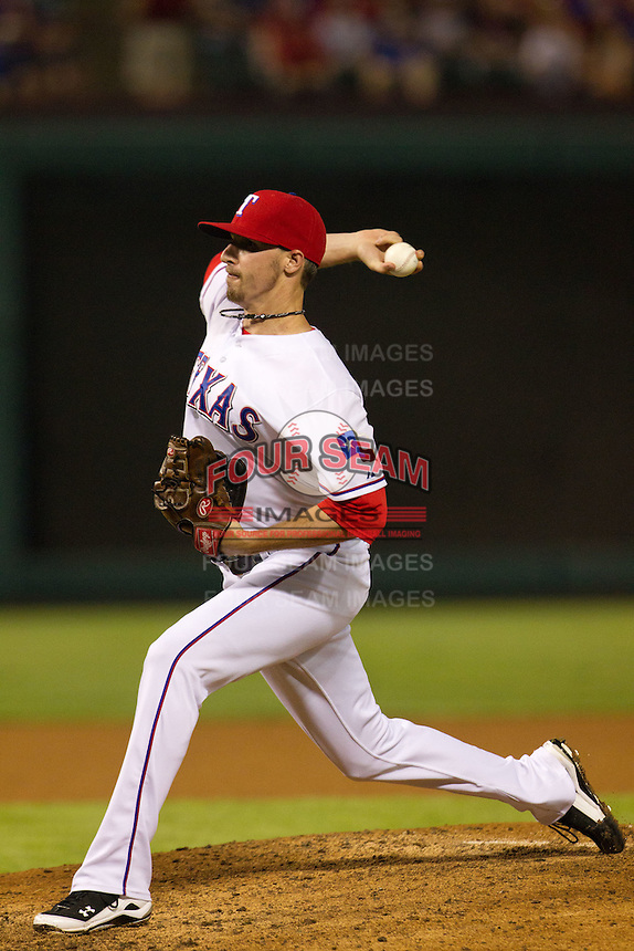 Texas Rangers pitcher Tanner Scheppers #52 delivers during the Major League Baseball game against the Baltimore Orioles on August 21st, 2012 at the Rangers Ballpark in Arlington, Texas. The Orioles defeated the Rangers 5-3. (Andrew Woolley/Four Seam Images).