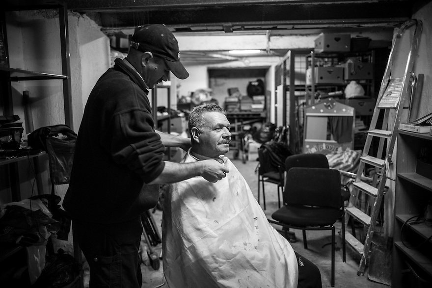 Valentin Razvan volunteers as a barber at Victory Outreach center, a shelter and soup kitchen for the homeless in Bucharest. Dan Motruc (having his hair cut) said it is very important for homeless people to appear clean and well-groomed.