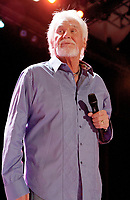 Kenny Rogers <br /> Legendary country singer and actor Kenny Rogers made a stop along with Glen Campbell at the Chastain Park Amphitheater in Atlanta, GA., where the two friends performed their hits for an enthusiastic crowd of fans, Atlanta, GA, USA, July 14th, 2012.<br /> music half length on stage microphone singing concert gig performing live purple shirt beard facial hair <br /> CAP/ADM/DH<br /> &copy;Dan Harr/AdMedia/Capital Pictures