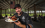 Chef Josh Cooper cooks BBQ chicken, ribs and brisket for a group of lobbyist friends in Jefferson County, Florida