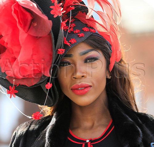 14h April 2018, Aintree Racecourse, Liverpool, England; The 2018 Grand National horse racing festival sponsored by Randox Health, day 3; Lady enjoying a day at the Grand National